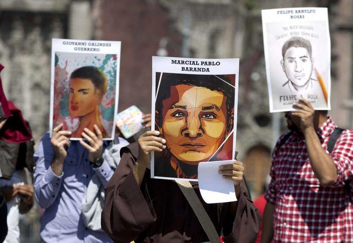 Tres detenidos confesaron que el 26 de septiembre recibieron al grupo de normalistas y los mataron. (Foto de Archivo/Agencias)