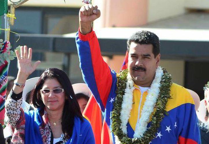 El presidente de Venezuela, Nicolás Maduro (d), y su esposa Cilia Flores (i). (EFE/Archivo)