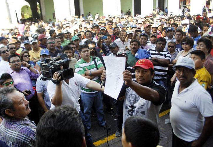 El representante de los pescadores, Armín Peraza Ortigoza, dijo que el acuerdo surtirá efecto entre tres y cuatro semanas. (Christian Ayala/SIPSE)