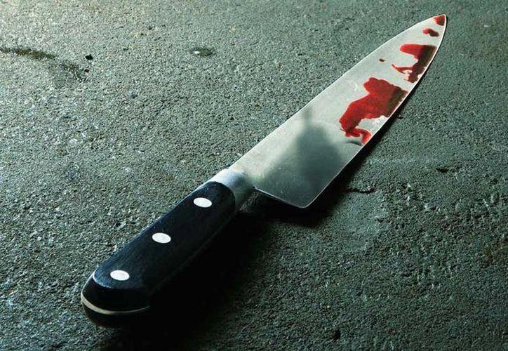 En la vivienda fueron localizados dos cuchillos, probables armas utilizadas en el homicidio. (Foto: Contexto)