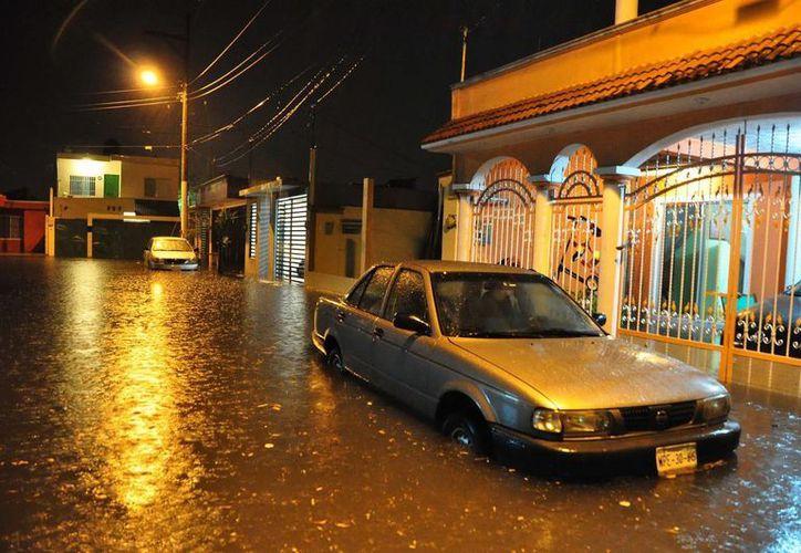 El fenómeno causa intensas lluvias en Oaxaca, Chiapas, Guerrero y Veracruz. (Archivo/Notimex)