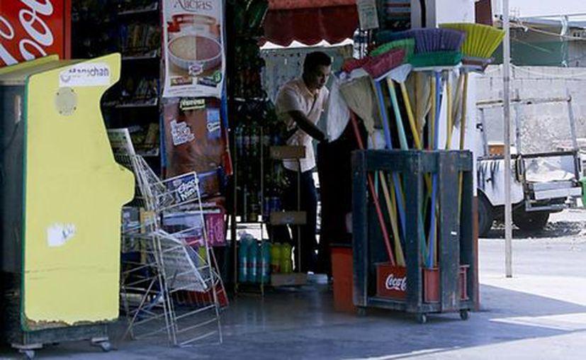Las tienditas ofertan a clientes principalmente bebidas y botanas. (Milenio Novedades)