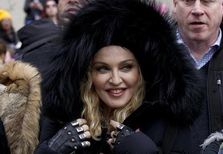 La cantante Madonna adoptó en Malawi a sus hijos David Banda y Mercy James, ambos cuentan con 12 años. (Archivo/AP)