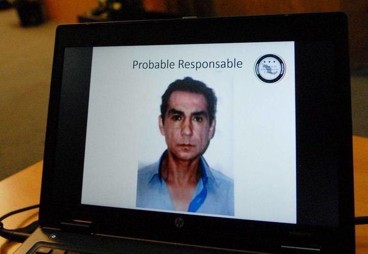 Imagen de José Luis Abarca en un televisor durante la rueda de prensa en que se informó de su detención, el 4 de noviembre de 2014. (Archivo/Notimex)