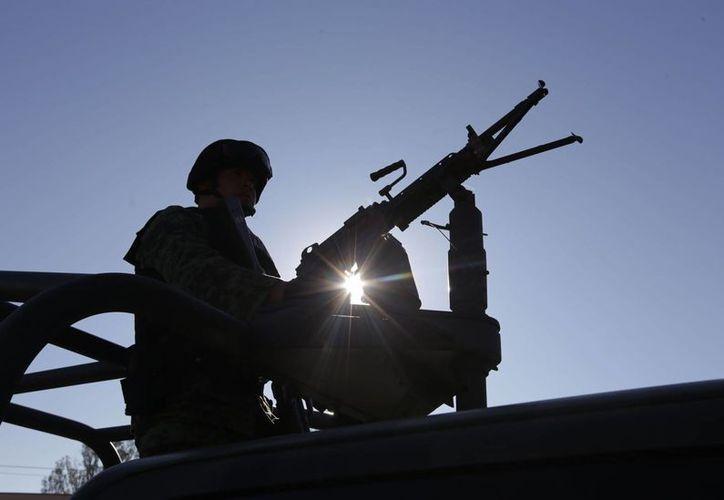 Ante la violencia que se registró en Michoacán, el gobierno decidió que entrará al Ejército a la entidad. (Archivo/Notimex)