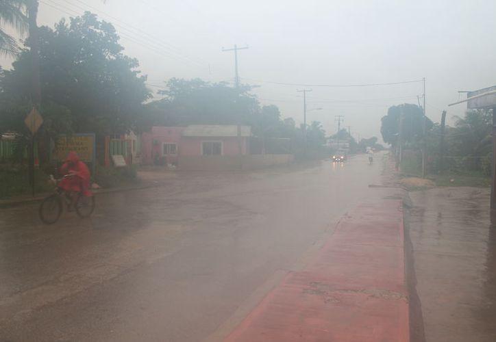 Las precipitaciones pluviales dejó encharcamientos en las principales avenidas.  (Gloria Poot/SIPSE)