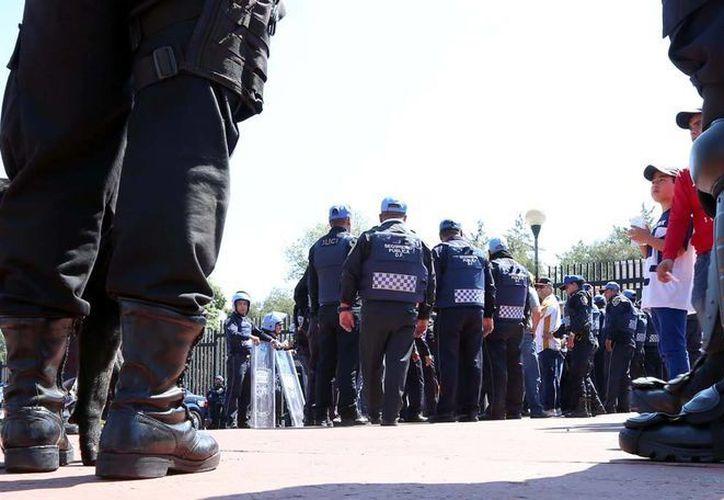 Los policías que participaron en un atraco en Saltillo, Coahuila, están bajo investigación. (Notimex)