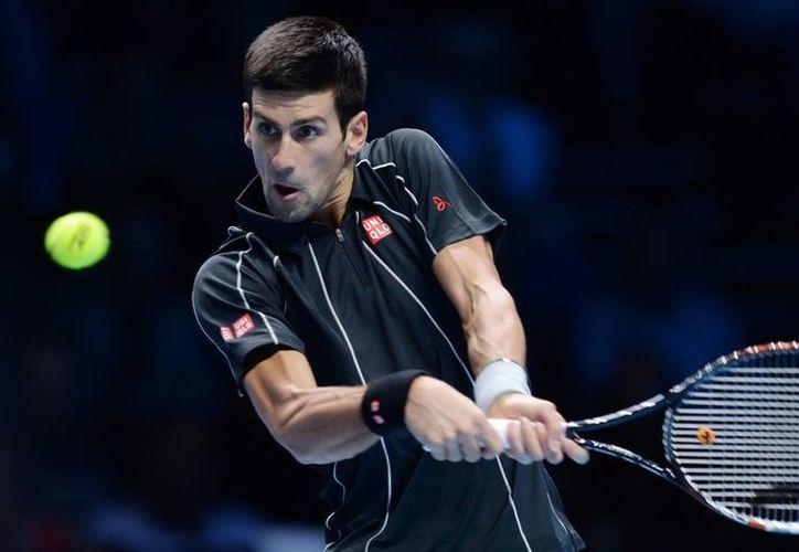 Djokovic se desquitó de la derrota sufrida ante Nadal en el US Open, al eliminarlo en la final de la Copa de Maestros de Londres. (EFE)