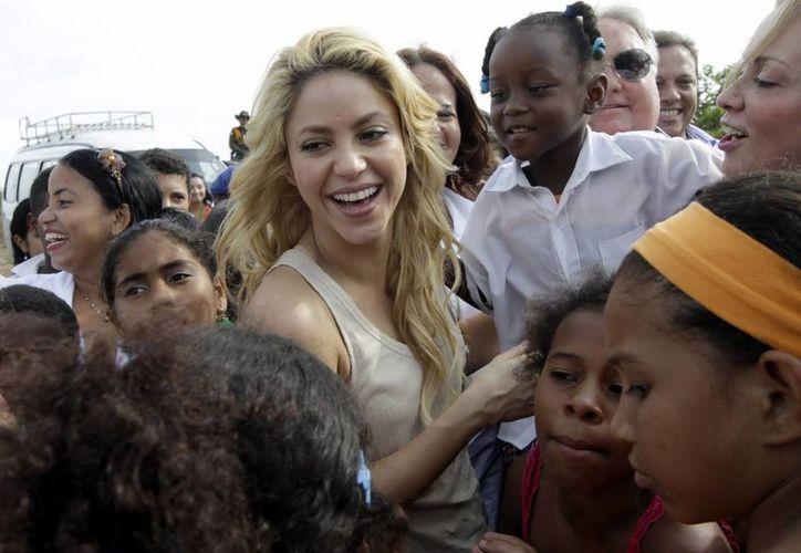 Shakira, quien puso la primera piedra del colegio en abril de 2011, será la invitada de honor en la inauguración del plantel, aunque su asistencia no está del todo confirmada. (EFE/Archivo)