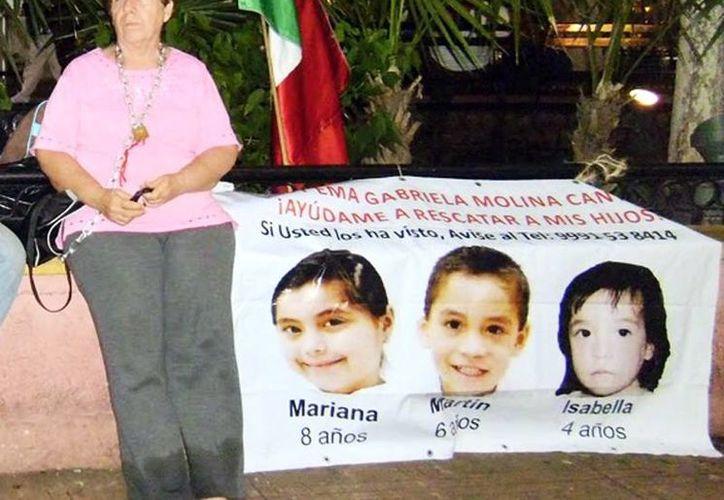 La señora Ligia Canto Lugo, durante una de sus protestas pidiendo justicia. (Milenio Novedades)