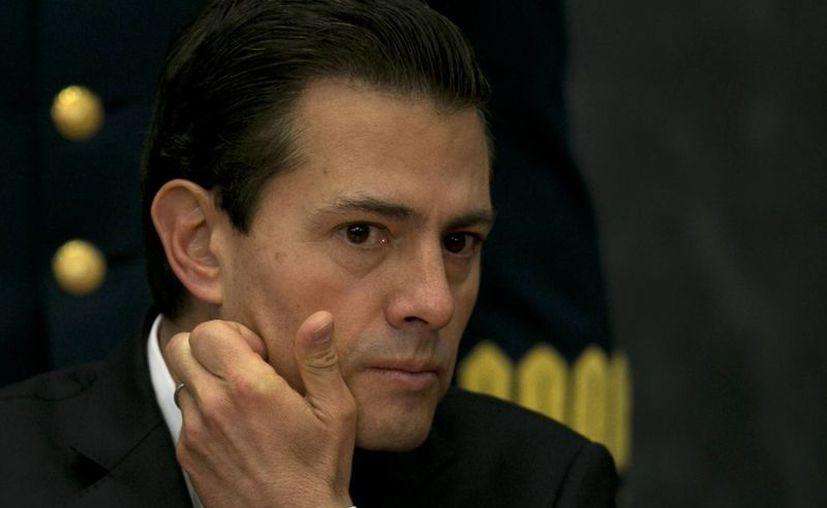 La Presidencia niega que Trump se haya dirigido al mandatario mexicano en tono ofensivo. (AP/Marco Ugarte)