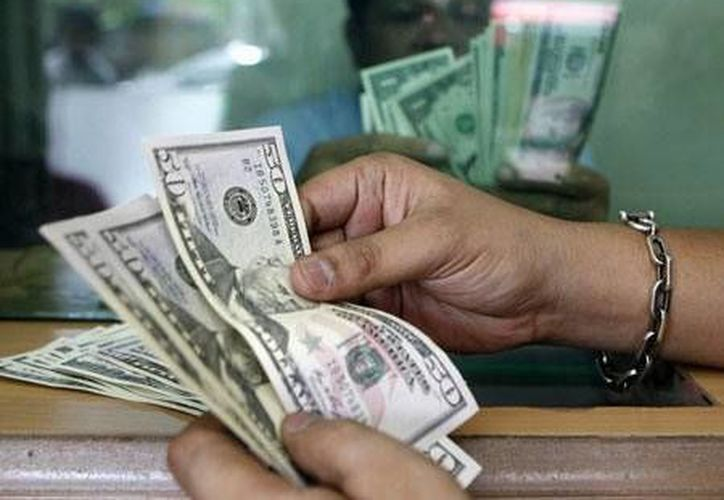 En Mérida se compró a 12.50 pesos y se vendió a 13.10 pesos. (Archivo/Reuters)