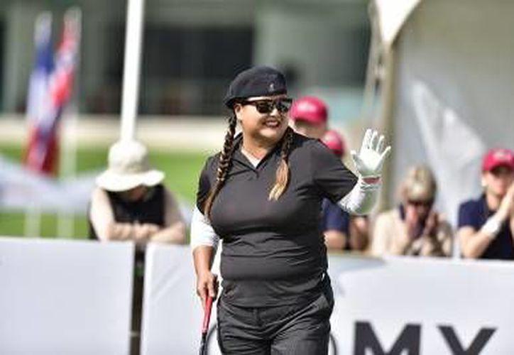 La golfista Christina Kim estuvo más errática que en la jornada inaugural, pero se mantuvo como líder en el Lorena Ochoa Invitational. (loi.mx)