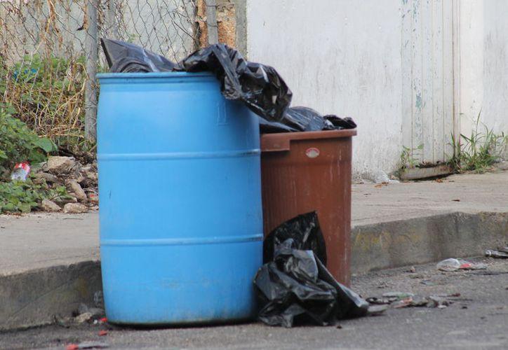 Los cuerpos fueron encontrados en unos tambos de basura en la Supermanzana 64. (Redacción/SIPSE)