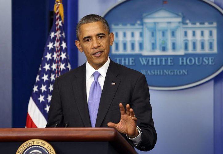 Obama ha minimizado los problemas que enfrenta la puesta en marcha de la iniciativa. (EFE)