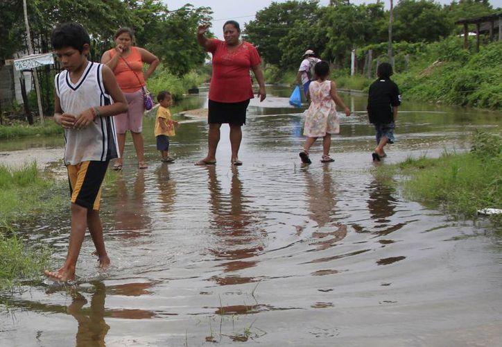La temporada de lluvias favorece la presencia de Infecciones Respiratorias Agudas (IRAS). (Harold Alcocer/SIPSE)