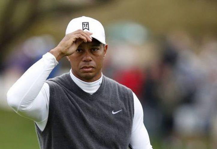 Tiger Woods se fue con un bogey en el último hoyo para terminar con un 82 en el Abierto de Phoenix. (Foto: AP)
