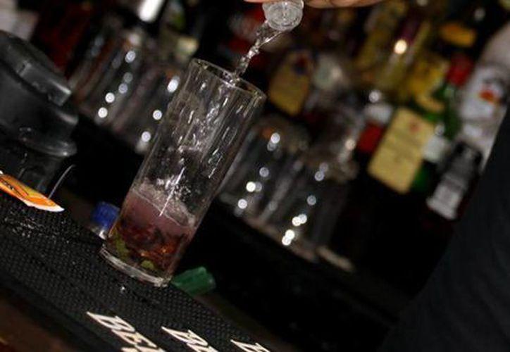 El dueño de un bar fue amenazado por un grupo de delincuentes a cambio de su 'seguridad'. (Foto de contexto/SIPSE)