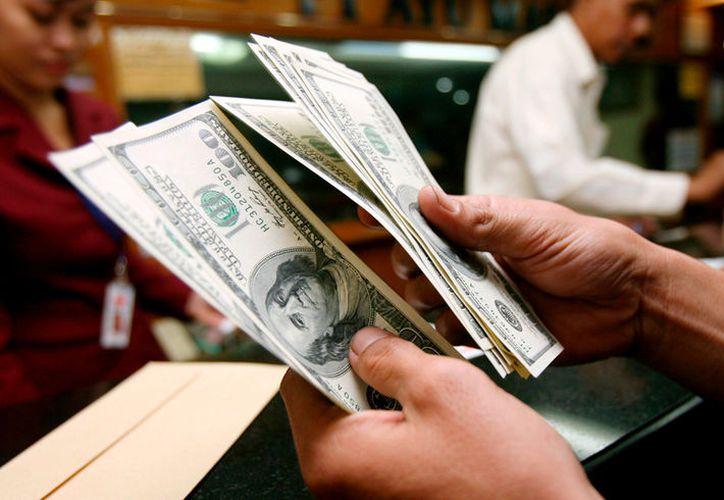 El Banco de México fijó en 19.0019 pesos el tipo de cambio para solventar obligaciones. (México Nueva Era).