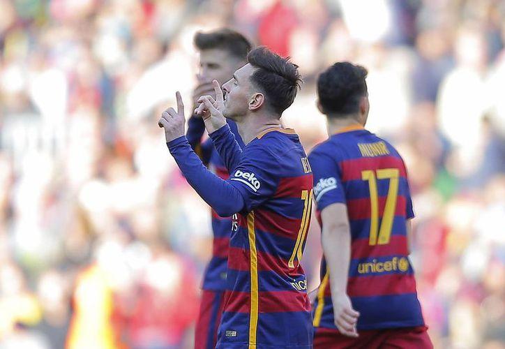 Lionel Messi comandó la goleada del Barcelona con una gran anotación ante el equipo de Getafe. (AP)