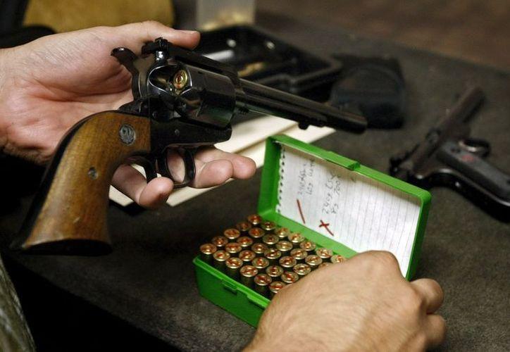 La novedad es que se podrán recolectar las armas a través de las comunidades religiosas. (EFE)