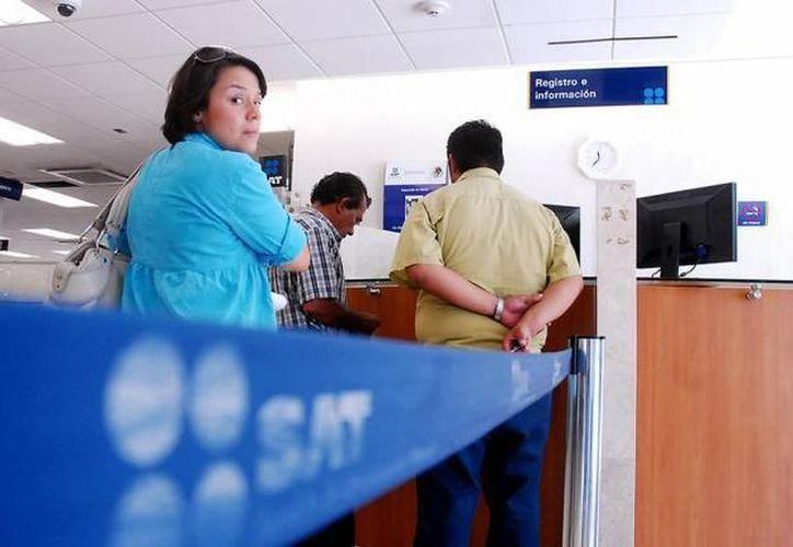 Según el SAT, se ha reducido el tiempo de reembolso a contribuyentes yucatecos. (Milenio Novedades)