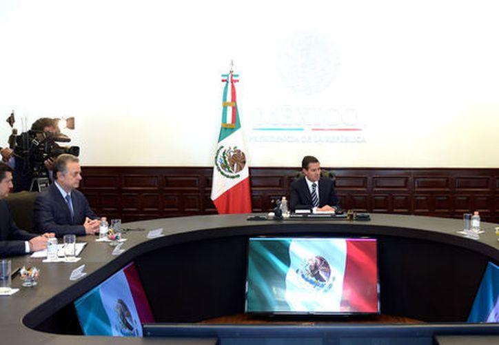 El presidente Peña Nieto se reunió ayer con el director Ejecutivo de General Electric, John Flannery (Notimex).