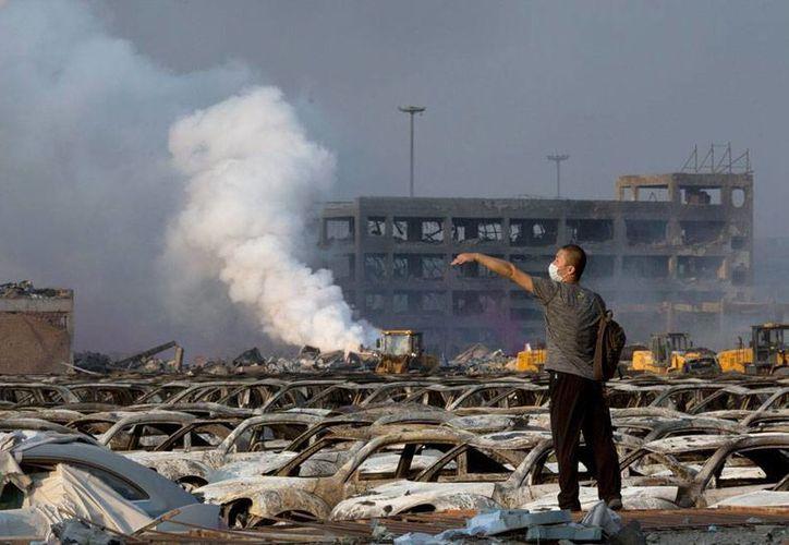 Hasta ahora, el saldo de víctimas mortales en un incendio en almacén, en China, es de 85 personas. (AP)