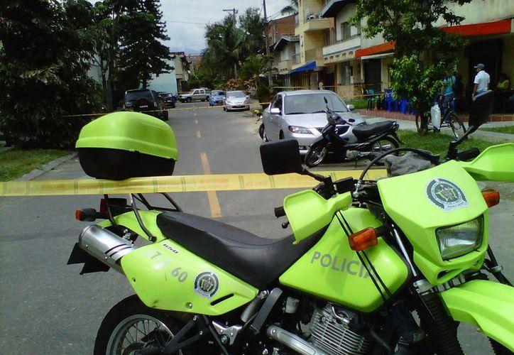 El 71.76 por ciento de esos homicidios en Colombia se cometieron con armas de fuego. (elcolombiano.com)