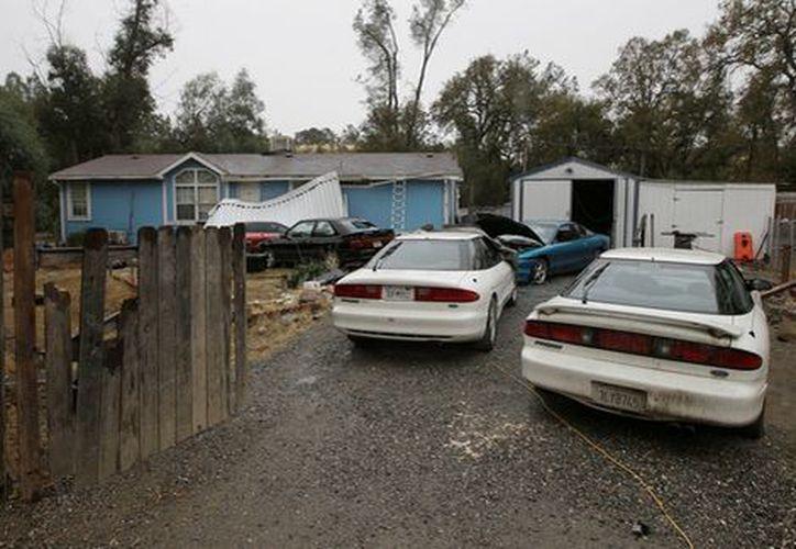 El cuerpo fue encontrado bajo el suelo de la casa de la pareja durante el registro policial. (Foto: AP)