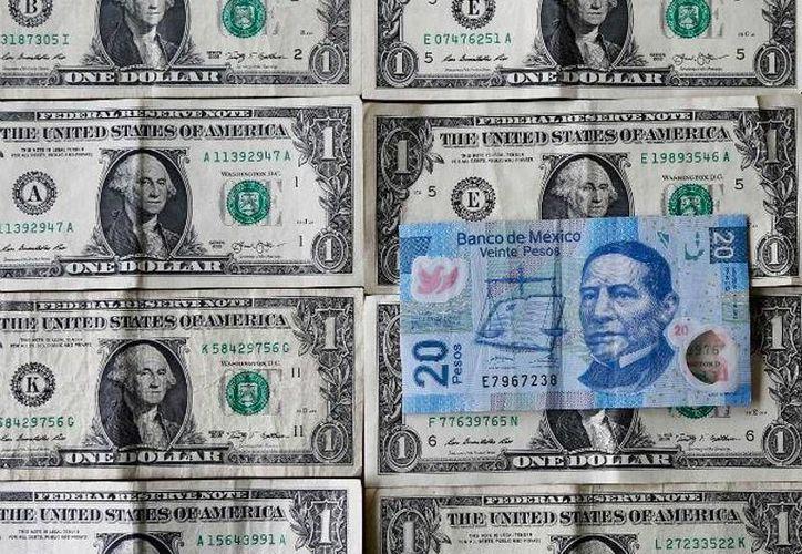 El dólar arrancó la jornada de hoy a la baja, en la apertura de los mercados financieros. La imagen es de contexto. (excelsior.com.mx)