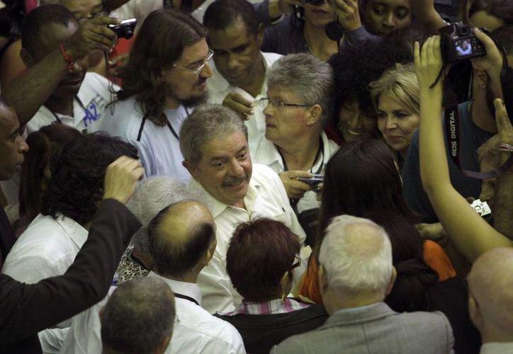 La visita del exmandatario brasileño causó revuelo en los medios oficiales. (Agencias)