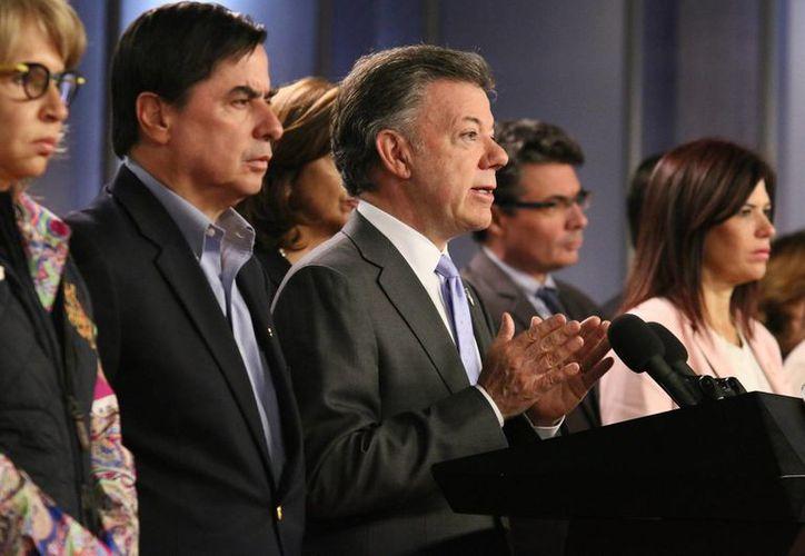 El presidente de Colombia, Juan Manuel Santos, dijo que se hará lo posible para liquidar el conflicto con las FARC antes del 31 de diciembre. (Archivo/Notimex)