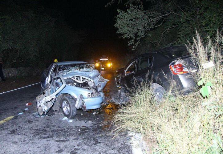 Imagen del terrible encontronazo entre dos vehículos en el tramo carretero Euán-Tixkokob. (Milenio Novedades)
