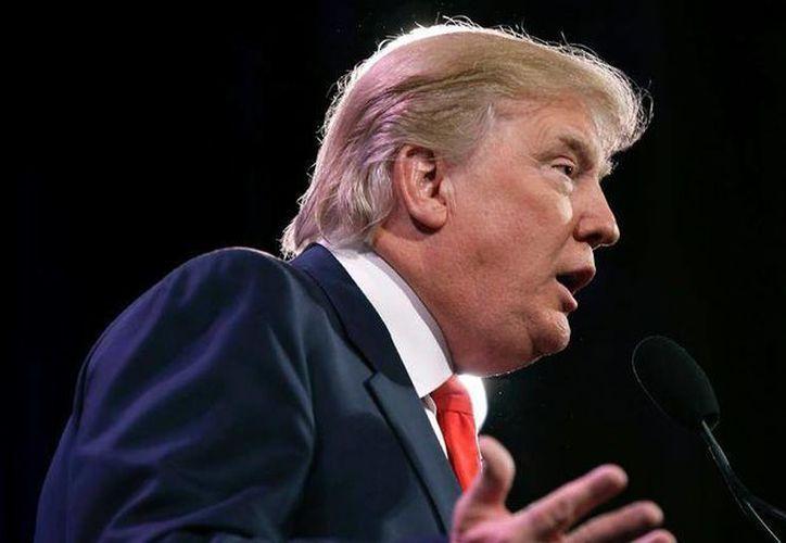 En esta imagen del 24 de enero de 2014 se ve a Donald Trump hablando en Des Moines, Iowa.(Foto AP/Charlie Neibergall, Archivo)