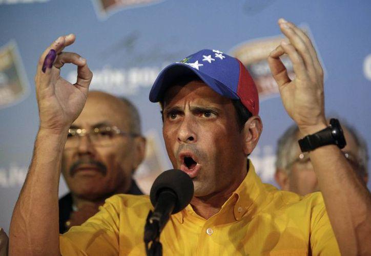 Capriles consiguió en las elecciones un 49.07 de los sufragios. (Agencias)
