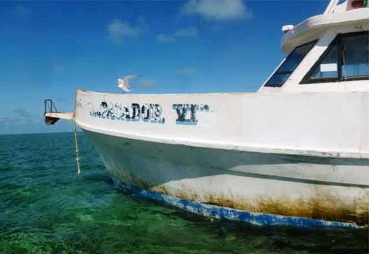 Tras los daños cometidos contra el Arrecife Alacranes en enero de 2015, este martes la Profepa dio a conocer la multa a la que hizo acreedor el propietario y patrón de la embarcación 'Empacador VI'. (Fotos: Profepa)