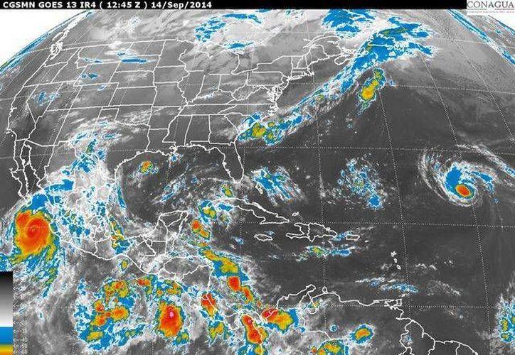 La onda tropical número 30 se localiza en el occidente del Mar Caribe. (Redacción/SIPSE)