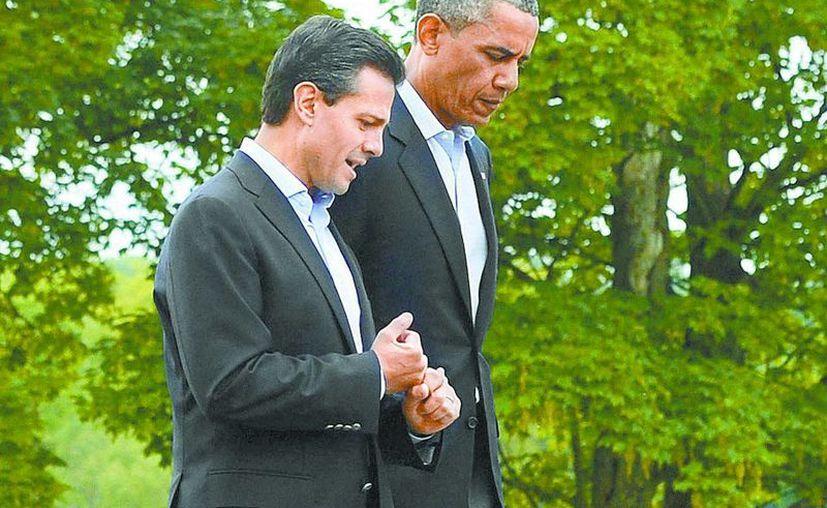 El mandatario mexicano tuvo tiempo para dialogar con su homólogo en EU, Barack Obama. (Milenio)