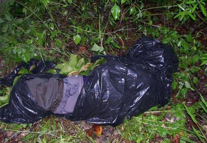 Hallan cuerpos embolsados de dos víctimas asesinadas a golpes. (Foto contexto. Archivo SIPSE)