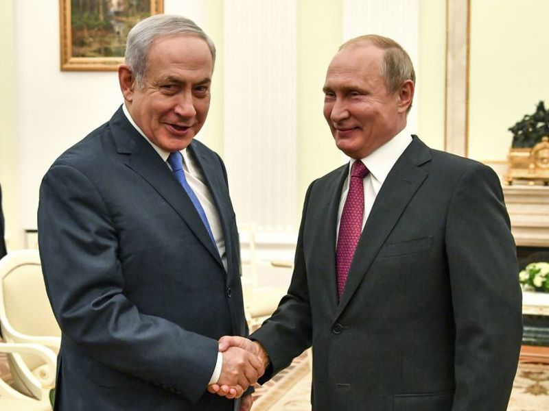 Russian President Vladimir Putin, right, shakes hands with Israeli Prime Minister Benjamin Netanyahu during their meeting at the Kremlin in Moscow.