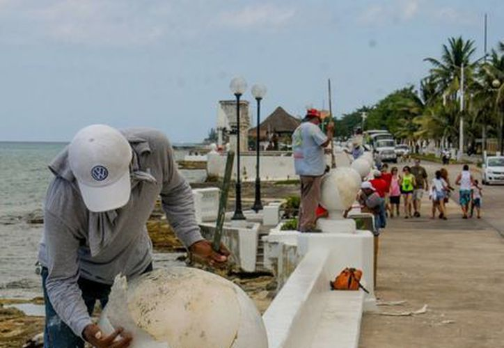 Implementan labores de limpieza, lavado de calles y  pintura en muros. (Cortesía/SIPSE)