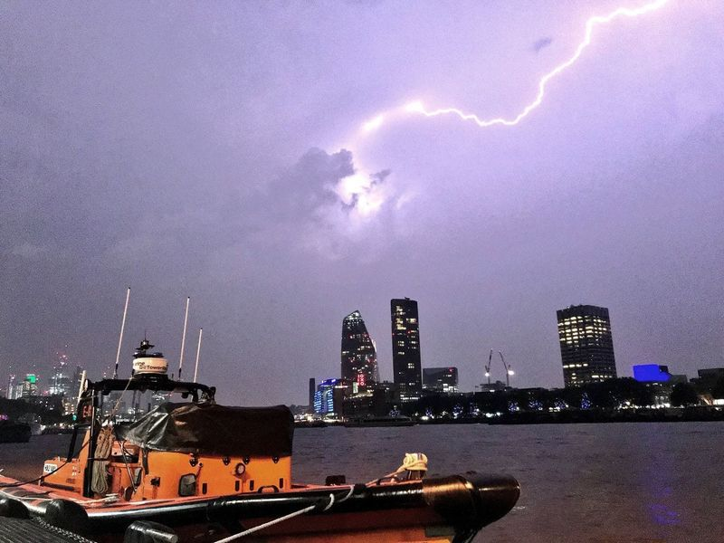 This photo made available by RNLI, shows a lightning strike during a storm in London, Saturday May 26, 2018. British meteorologists say up to 20,000 lightning strikes hit the U.K. during a powerful overnight thunderstorm, and a London-area airport is reporting flight disruptions after an aircraft refueling system was damaged. (Matt Leat/RNLI / AP)