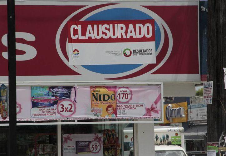 Las multas por incumplir con la normatividad de Imagen Urbana van de 250 a 500 salarios mínimos.  (Tomás Álvarez/SIPSE)