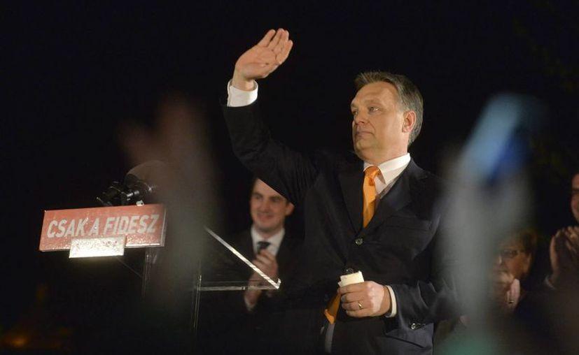 Las elecciones parlamentarias de Hungría terminaron hoy con la esperada victoria del primer ministro, el conservador nacionalista Viktor Orbán, con el 46 por ciento de los votos, según indican los primeros datos oficiales. (EFE)
