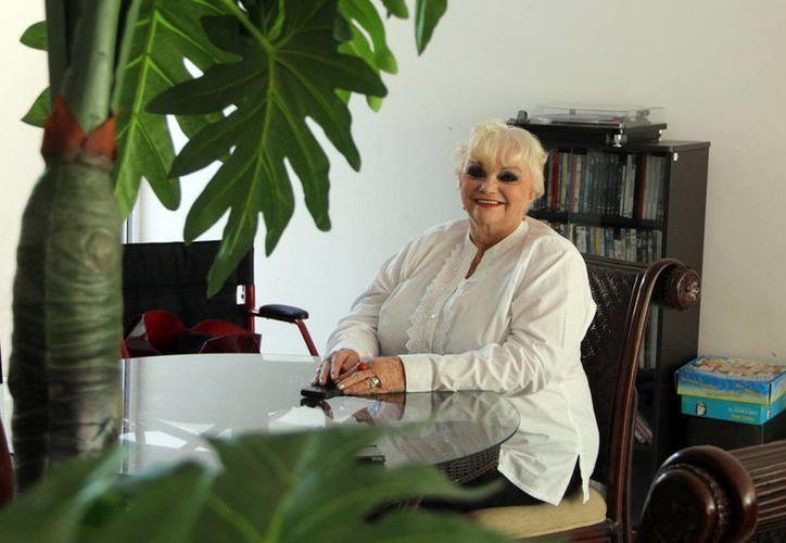 La generosidad de Libia Esther Novelo Domínguez es una herencia de sus padres y que ahora fomenta en su familia. (Milenio Novedades)