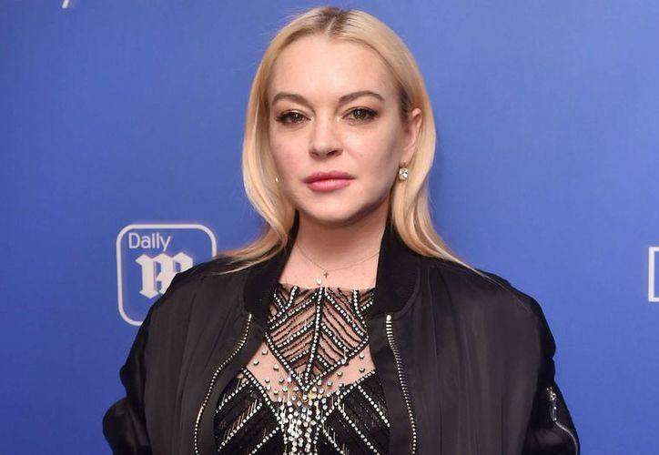 La actriz Lindsay Lohan intentó llevarse a uno de sus niños y finalmente recibió un puñetazo en la cara. (Foto: Celebrity Insider)