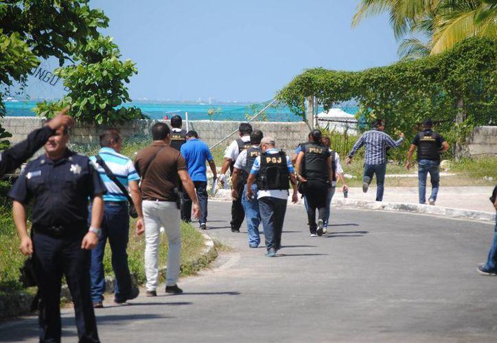 La ejecución se registró en una playa de la zona hotelera. (Eric Galindo/SIPSE)