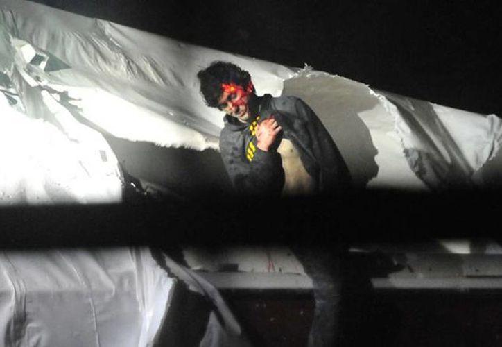 Las fotos fueron tomadas cuando Tsarnaev fue capturado el 19 de abril pasado, sangrando y escondido en un bote. (Boston Magazine)