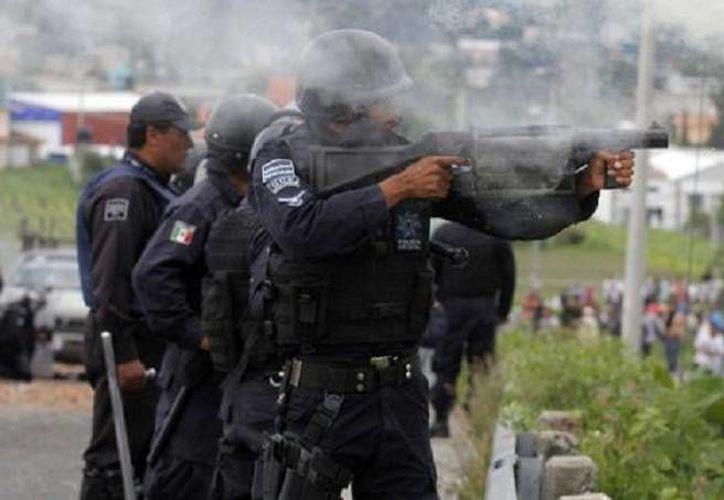 En el operativo para dar con los responsable del enfrentamiento del 9 de julio en Puebla, los agentes ministeriales catearon el domicilio del edil auxiliar de Chalchihuapan, Javier Montes, quien no estaba en el lugar y no fue detenido. (Foto  de archivo de Milenio)